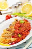 Pieces of fried fish with fresh herbs and lemon. — Stock Photo
