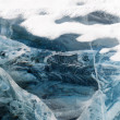 Network of cracks in thick solid layer of ice — Stock Photo #35456457