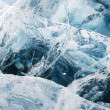 Network of cracks in thick solid layer of ice — Stock Photo