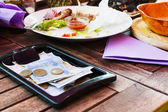 Payment lunch at the restaurant. — Stock Photo