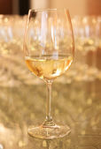 Wine glass filled with wine. — Stock Photo