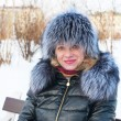 Stock Photo: Portrait of a woman in a fur hat.