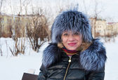 Portrait of a woman in a fur hat. — Stock Photo