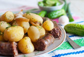 Boiled potatoes with slices of grilled sausage. — Stock Photo
