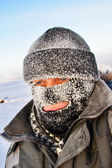 Portrait of a man in a cap and a ski mask. — Stock Photo