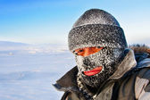 Portrait of a man in a cap and a ski mask. — Stockfoto