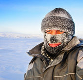 Portrait of a man in a cap and a ski mask. — Foto Stock