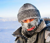 Portrait of a man in a cap and a ski mask. — Stok fotoğraf