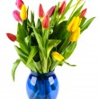 Bouquet of tulips in a blue glass vase. — Stock Photo #40335089