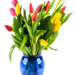 Bouquet of tulips in a blue glass vase. — Stock Photo #40338129