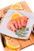 Boiled shrimp on a square plate. — Stock Photo