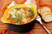 Ceramic bowl with rice pilaf. — Stock Photo