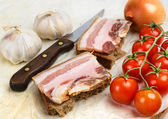 Of salted bacon sandwiches on rye bread. — Stock Photo