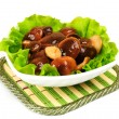 Marinated mushrooms with lettuce leaves. — Stock Photo #42028765