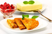 Pancakes with strawberries  and briquette butter — Stock Photo