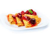 Pancakes with strawberry jam. — Stock Photo
