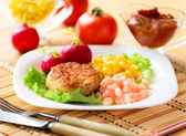 Chicken cutlets with canned corn and shrimp. — Stock Photo