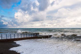 Storm waves roll on the breakwater. — Stock Photo