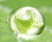 Earth in waterdrop — Stock Photo