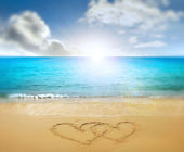 Hearts drawn in beach — Stock Photo