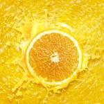 Orange juice splashing — Stock Photo