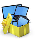 Mobile tablet devices and the open gift box — Stock Photo