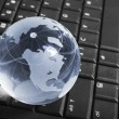 Globe on a keyboard — Stock Photo