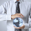 Stock Photo: Earth globe in his hands