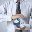 Earth globe in his hands — Stock Photo