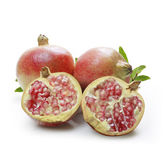 Ripe pomegranates with leaves — Stock Photo