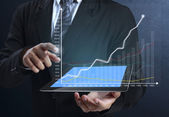 Touch screen graph on tablet in hands — Stock Photo