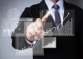 Símbolos financeiros provenientes de mão — Foto Stock