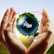 Earth globe in his hands — Stock Photo #32040935