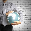 Earth globe in his hands — Stock Photo #32040943