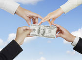 Hands holding a dollar note — Stock Photo