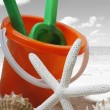 Spade and bucket on  beach — Stok fotoğraf