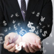 Financial symbols coming from hand — Stock Photo #36381853