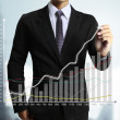Business man hand drawing graph — Stock Photo #36382359