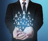 Soziales netzwerk-struktur in der hand — Stockfoto