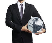 Holding a glowing earth globe in his hand — Stockfoto