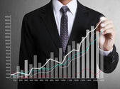 Business man hand drawing graph — Stock Photo