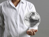 Holding a glowing earth globe in his hands — Stock Photo