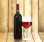 Red Wine bottle and glass — Stock Photo