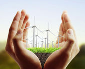 Wind turbine in  hand  — Stock Photo
