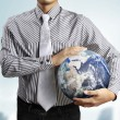 Holding a glowing earth (NASA) globe — Stock Photo #48285739