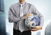 Holding a glowing  earth (NASA) globe — Stock Photo