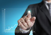 Business man pointing at growth graph — Stock Photo