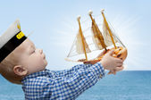 Small captain with the ship — Stock Photo