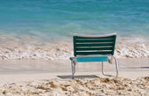 Empty chair on a sandy beach — Stock Photo