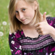 Girl the student shows gesture OK — Stock Photo #33940391